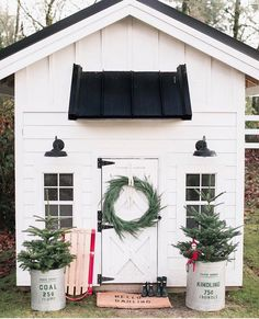 White shed decorated for Christmas