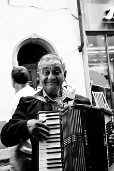 Florence, Italy: Accordian player serenading the outdoor seating at a number of restaurants.