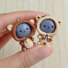 Two new kitties in their cute onesies : a bear and a leopard! Which one is your favorite?  ~ Deux nouveaux petits chats en pyjama : un ours et un léopard  Lequel préférez-vous?  #kitty #onesie #polymerclay #polymerclaycharms #polymerclaycreations #fimo #fimoclay #fimocreations #clay #claycharms #claycreations #handmade #kawaii #patepolymere #patefimo #faitmain #chat