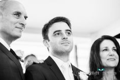 The handsome groom watches his bride walk down the aisle. Just LOVE when the groom is a total softie :)
