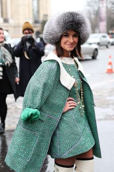 Miroslava Duma in a green tweed Chanel suit and Chanel boots.