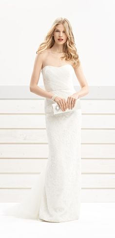 Bliss Monique Lhuillier wedding dress (#BL1408), lace with sheer tulle overlay and detachable skirt
