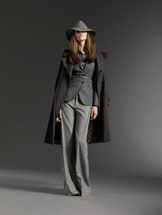 the Gucci look has such a mysterious private investigator in the 1950's feel. love the slick tailoring.