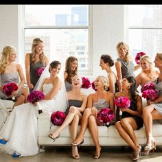 I like this picture. gray bridesmaids with purple flowers