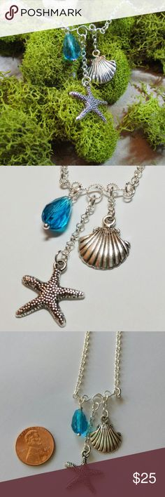 "Ocean Necklace Sea Shell Starfish Silver Tone Necklace with Sea Shell, Starfish and Blue Glass Bead. ♥ This pendant is a great gift for yourself or the one you love. ♥ Comes in a beautiful pillow gift box - ready for gift giving!   This necklace is made of: ♥ Silver Tone Sea Shell Charm ♥ Silver Tone Starfish Charm ♥ 16"" chain +2"" extension chain ♥ Blue Glass Teardrop  Handmade by me. Handmade Jewelry Necklaces"