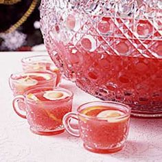Orange Sherbet Party Punch (•4 cups water, divided  •1 package (6 ounces) strawberry gelatin  •1-1/2 cups sugar  •1 can (46 ounces) pineapple juice  •1 can (46 ounces) orange juice  •1 cup lemon juice  •1/2 gallon orange sherbet, softened  •1 liter ginger ale, chilled)