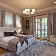 The wall color we selected for this room is called Poised Taupe SW 6039 by Sherwin Williams. Also like the trey ceiling.