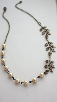 Asymetrical leaf motif/wired pearls necklace
