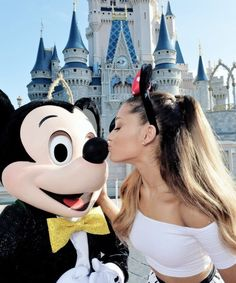 Ariana Grande at Disneyland! That shirt is perfect on her!! I don't know why, but it is!