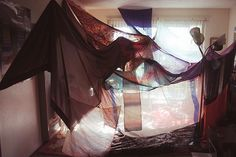 Use gauze and scarves to make a tent entrance to the room (or around the bed)