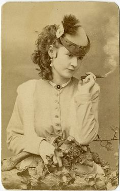 Stage actress Lotta Crabtree smoking a cigar. She was active in the 1880s earning up to 5K a week and when she died in 1924 she left an estate worth 4 million. She donated a fountain to San Fran at Market & Kearny where people meet to mark the anniversary of the 1906 earthquake.