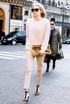 head-to-toe blush with black sandals and a gold crushed velvet bag