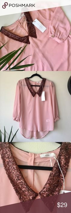 """Lush pink blouse Lush beautiful pink high low blouse with sequins all over the neckline 3/4 sleeves and gold buttons down the back ... please see pictures for details! Shoulder to shoulder 14,5"""" pit to pit:20"""" length:24"""" back length:27,5"""" arms: 17,5"""" . Lush Tops Blouses"""