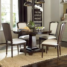 Universal Proximity Dining Set with Round Table and Cane-Back Side Chairs at Belfort Furniture
