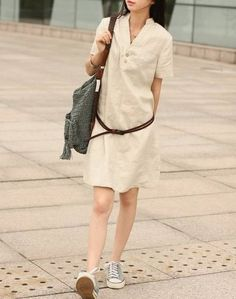 linen shirt dress: easy to dress up, or down. Sneakers and belt, and maybe a vest. Heels and a long, draping necklace. The simplicity of it is this outfit's greatest strength.