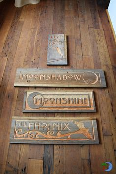 Custom Carved Wooden Signs by Josh Gambetta to be placed at Blue Moon Rising