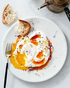 Inspired by a traditional Turkish breakfast, this recipe tops poached eggs with tangy yogurt and spicy butter.