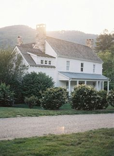 white farmhouse. love the mix of 2 roof materials.