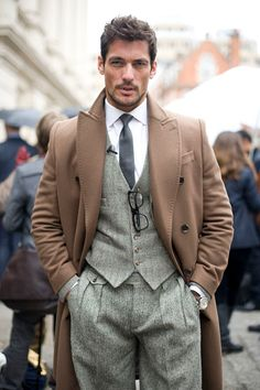 A 3-piece suit for men with a classic neutral trench coat will never go out of style.