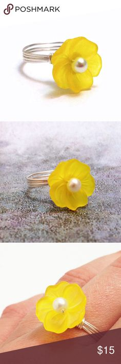 Yellow Lucite Flower Handmade Wire Wrapped Ring A lucite flower with a white pearl center wrapped with coated copper wire. The bright yellow color really stands out. This ring is held together with nothing but wire; no glue has been used and all sharp ends have been filed. The wire will not leave black marks on your finger. These rings are made to order, and I can also do bronze- or gold-colored wire, and different flower/center colors. Please ask! Not intended for children under 12. Jewelry…