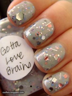 Normally not the biggest fan of nail glitter (it's sooo hard to take off!) but this is great. And the nail polish color name is equally cute.