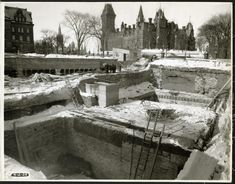 View of the National War Memorial construction site; large square pits, and builders working with lumber, in the middle ground; the East Block is in the background, February Source: Library and Archives Canada Fire Hall, Hill Park, Union Station, Photo Archive, Ottawa, Historical Photos, Ontario, Free Recipes, Past