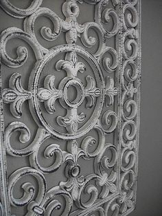 "Turn a rubber floor mat into an ""iron"" wall hanging. Looks fantastic and is lighter to hang."