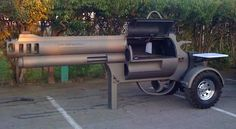 In 2010, welding students Stefan Harlicker, Mark Ramsay, Garret Belgarde, Dylan Decrow and Kanyen Bauer of Idaho's Sandpoint High School spent nearly an entire school year creating a tow-able bbq grill in the likeness of a .500 Smith and Wesson Magnum revolver. The 15-foot-long bbq grill was commissioned by Idaho gun retailer Wrenco Arms who uses it as a marketing tool for their business. I'm hoping they are using a Condiment Gun to put ketchup and mustard on their grillables.