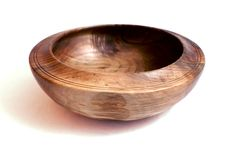 Black walnut wood has a gorgeous grain, a glowing patina, and it is lightweight, strong and durable. This hand-turned bowl is a gorgeous representation of the characteristics of black walnut wood. The