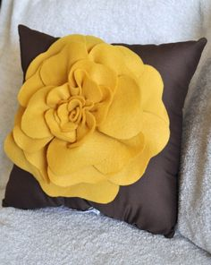 gray background with a green flower... mmm. I love throw pillows.