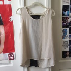 Sheer Sleeveless Top Chiffon top with lace on back, worn but good condition and can wear with so much just doesn't fit me as well anymore! Size is not on the shirt anymore but I say it would fit best on M-L Tops Blouses