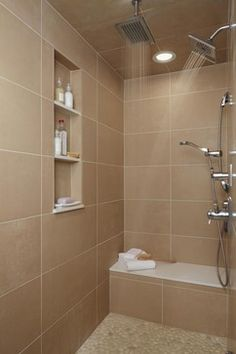 Large Walk In Tiled Shower, Tiled Shelves and seat. Double shower heads.  Xstylesbath.com Made in Michigan