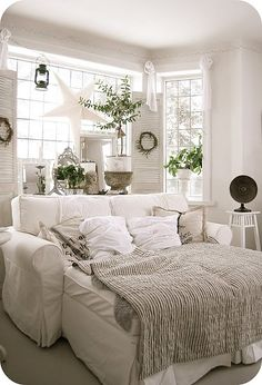 All white living room and yet so warm and cozy