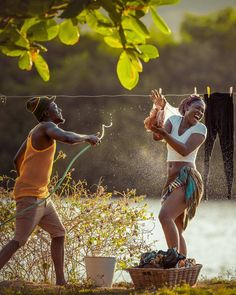 Hanging clothes on the clothes line play black love black couples laughing water play water hose Couples that play together ❤️❤️❤️ country Black Love Couples, Black Love Art, Beautiful Black Women, Cute Couples, Power Couples, Beautiful People, African Love, African Beauty, African Art
