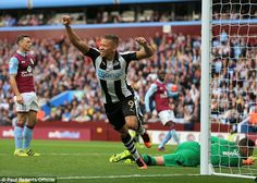 Dwight Gayle celebrates after Villa defender Tommy Elphick steered the ball into his own net