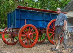 Wheelwright Andrew De Lisle with a newly built wagon