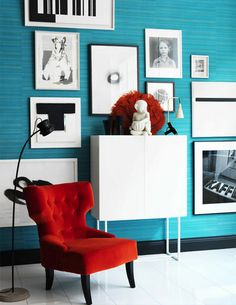 Divine velvet orange chair against blue wall.