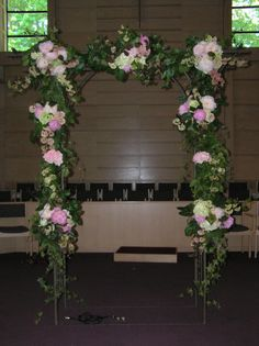 Arch with Pink Viburnum, Peonies, Hydrangea and miscellaneous foliages