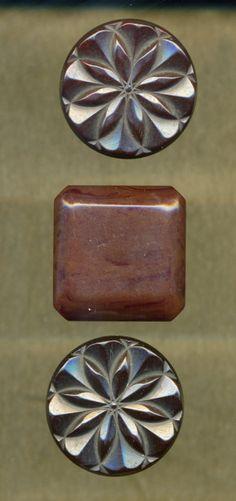 Carved Bakelite Brown Buttons
