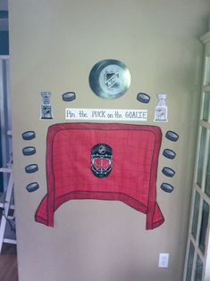 #hockey #played #goalie #party #kids #puck #pin #the #onHockey party- kids played pin the puck on the goalie