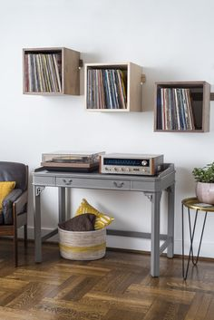Deep Cut record shelves in walnut and hard maple cascading in a mid-century setting with a vintage hifi system