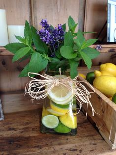 Mint lavender bouquet in a vase filled with lemons and limes...All Natural and full of fragrance. Basil or other herbs look beautiful too! Great for center pieces, room freshness, or to jazz up your kitchen or bathrooms with a splash of color!