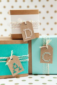 Take your gift tag making to the next level with these personalized cross-stitch gift tags. This tutorial includes a free printout of all your letters. Monogram Cross Stitch, Cross Stitch Alphabet, Creative Gift Wrapping, Creative Gifts, Cute Gifts, Diy Gifts, Art Du Fil, Diy Monogram, Paper Embroidery