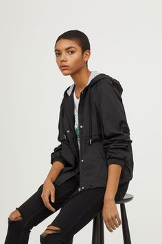 Short jacket in woven fabric with a jersey-lined, drawstring hood. Zip at front with wind flap and snap fasteners. Raglan sleeves with elasticized cu Black Rain Jacket, Rain Jacket Women, Stylish Coat, H&m Online, Hooded Jacket, Fashion Online, Black Women, Kids Fashion, Windbreaker