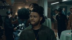 """Pin for Later: 18 Facts About The Weeknd That Are Guaranteed to Surprise You He's Even Managed to Make Kanye West Dance and Sing — at the Same Time! During The Weeknd's 2015 MTV VMAs performance of """"Can't Feel My Face,"""" Kanye let loose and got down in the audience like nobody was watching."""