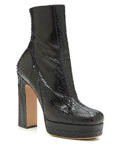 These black python platform booties from Rochas feature a paneled construction Internal zip Python exterior Leather insole, outsole and lining Made in Italy Please note: This item is returnable Python, Peep Toe, Booty, Zipper, Heels, Construction, Shopping, Accessories, Clothes