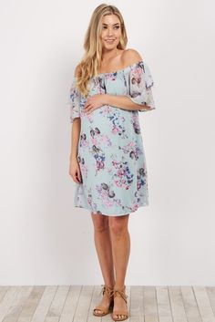 Elegant and beautiful, you'll fall in love with this floral maternity dress like we did. With a pretty off shoulder cut and light flowy chiffon, you'll feel and look amazing. Simply pair with a choker necklace and wedges for a stylish look.