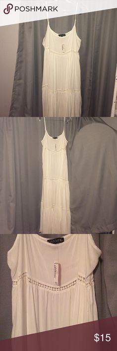 Flowy eyelet detail dress Long white flowy maxi dress. NEW UNWORN 56 1/2 inches long from shoulder to floor Love Culture Dresses Maxi