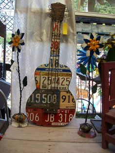 guitar from vintage old license plates; upcycle, recycle, salvage, repurpose, diy; for ideas and goods shop at Estate ReSale & ReDesign, Bonita Springs, FL