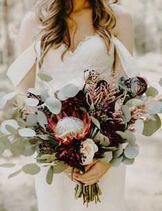 protea and eucalyptus leaves wedding bouquet for boho theme, burgundy and sage green wedding color themes burgundy protea and eucalyptus leaves wedding bouquet for boho theme Bouquet De Protea, Protea Wedding, Boho Wedding Bouquet, Bridesmaid Bouquet, Floral Wedding, Wedding Flowers, Fall Wedding, Wedding Bouquets, Dream Wedding
